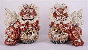 A Pair Of Japanese Porcelain Lion Dog