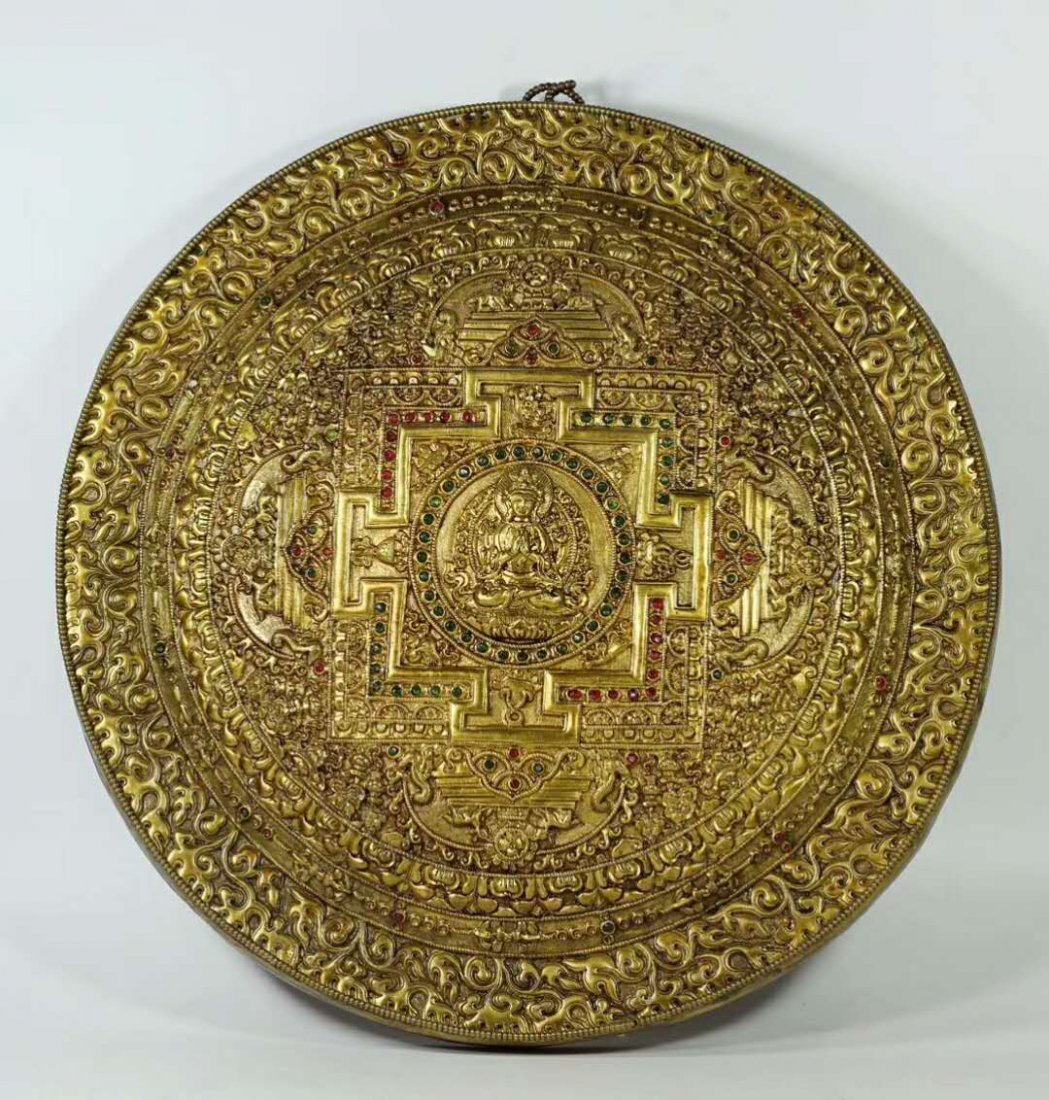 A Gilt Bronze Disk Depicting Buddha with Gemstone Inlay