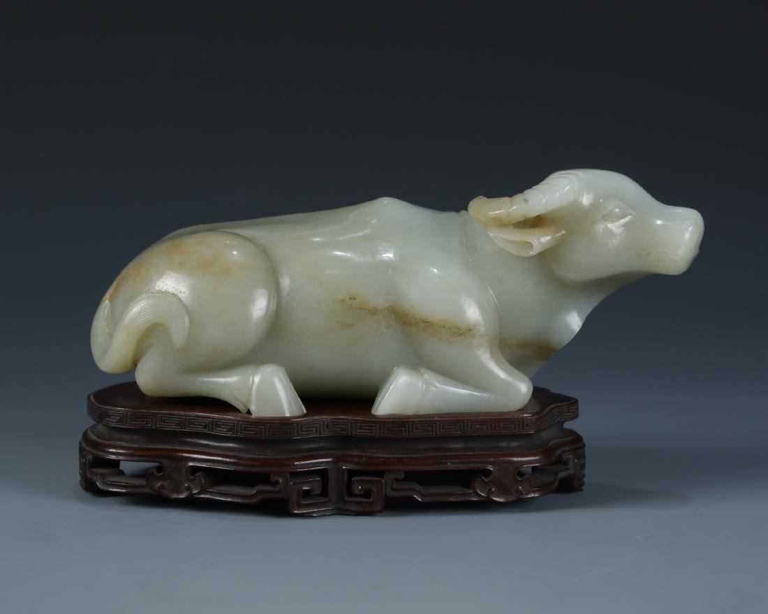 Carved White Jade Cow on wood base