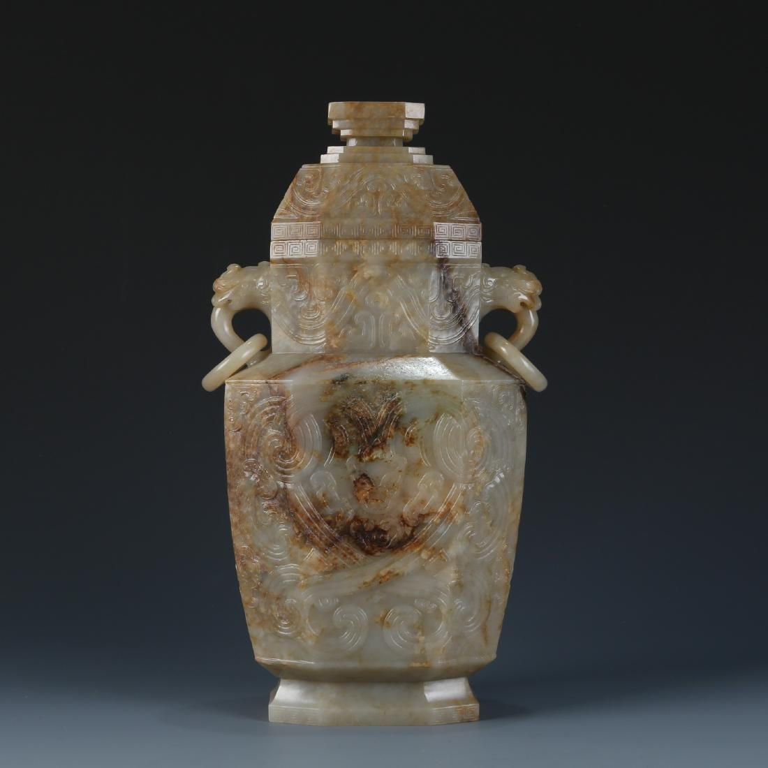 A Large Celadon Jade Archaistic Vase and Cover