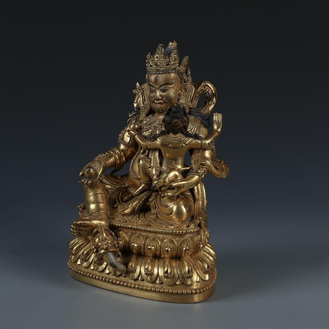 A Fine Gilt Bronze Figure of Jambhala, Tibetan, 17/18th - 4