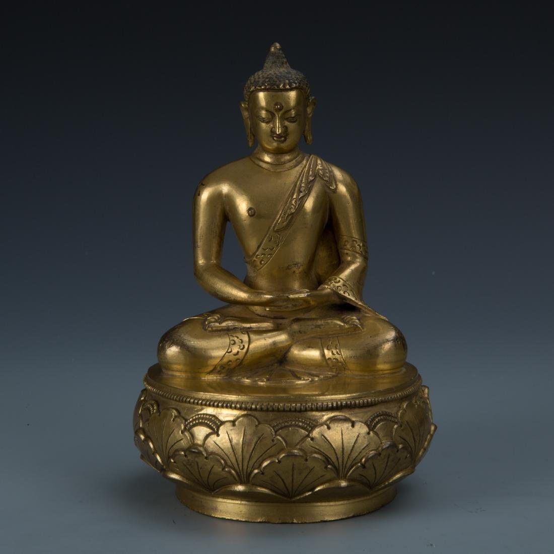 Rare Gilt Bronze Seated Buddha on a Rounded Lotus Base