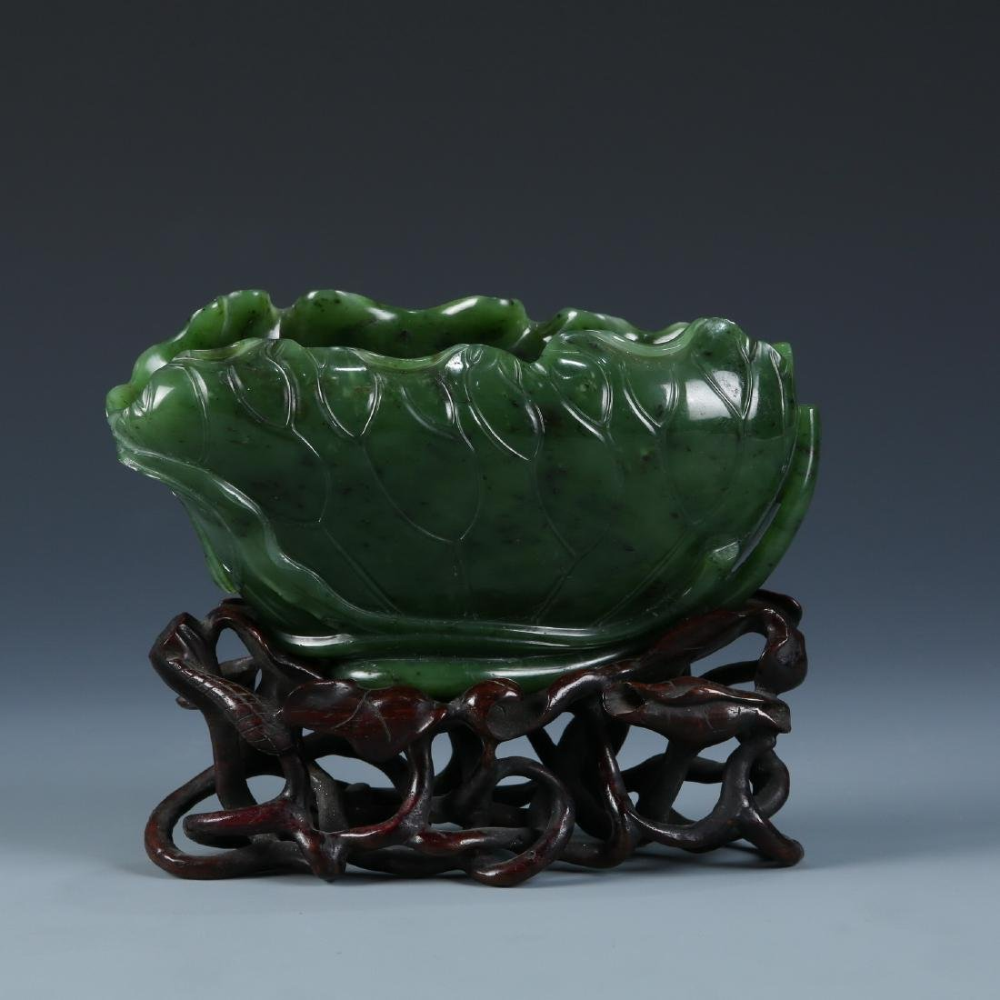 A Fine Carved Spinach Green Jade Lotus Washer