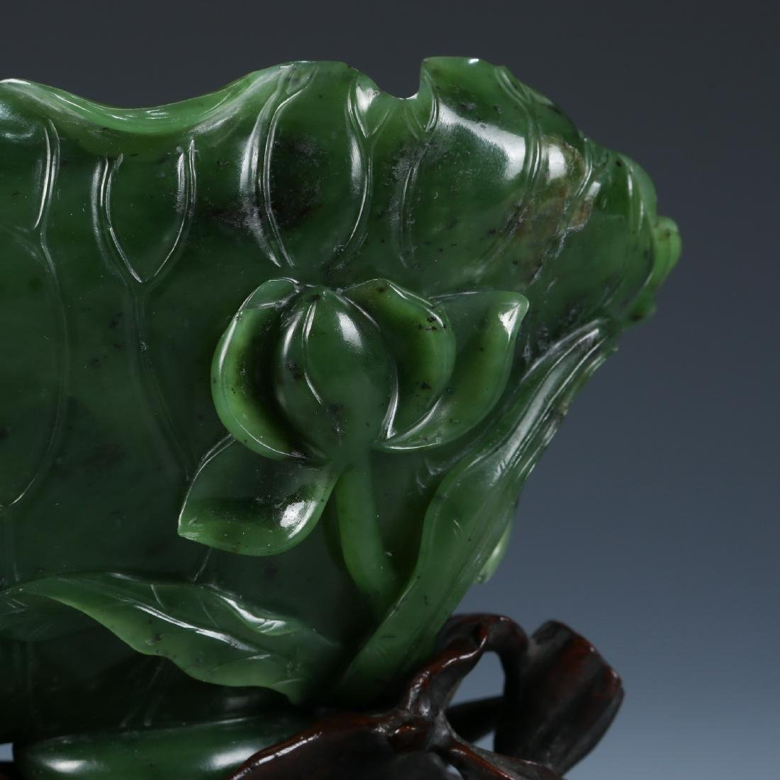 A Fine Carved Spinach Green Jade Lotus Washer - 4