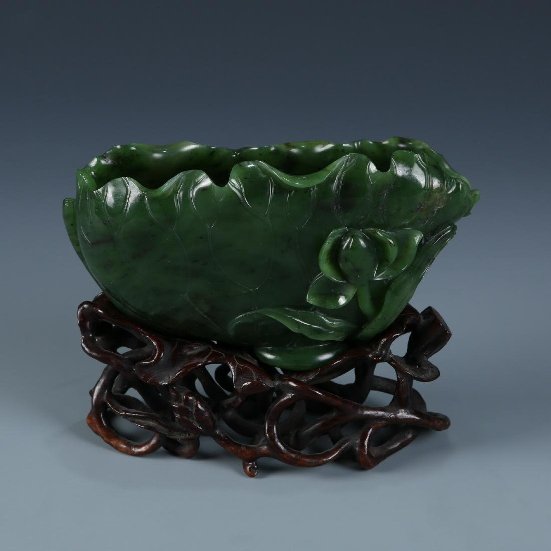 A Fine Carved Spinach Green Jade Lotus Washer - 7