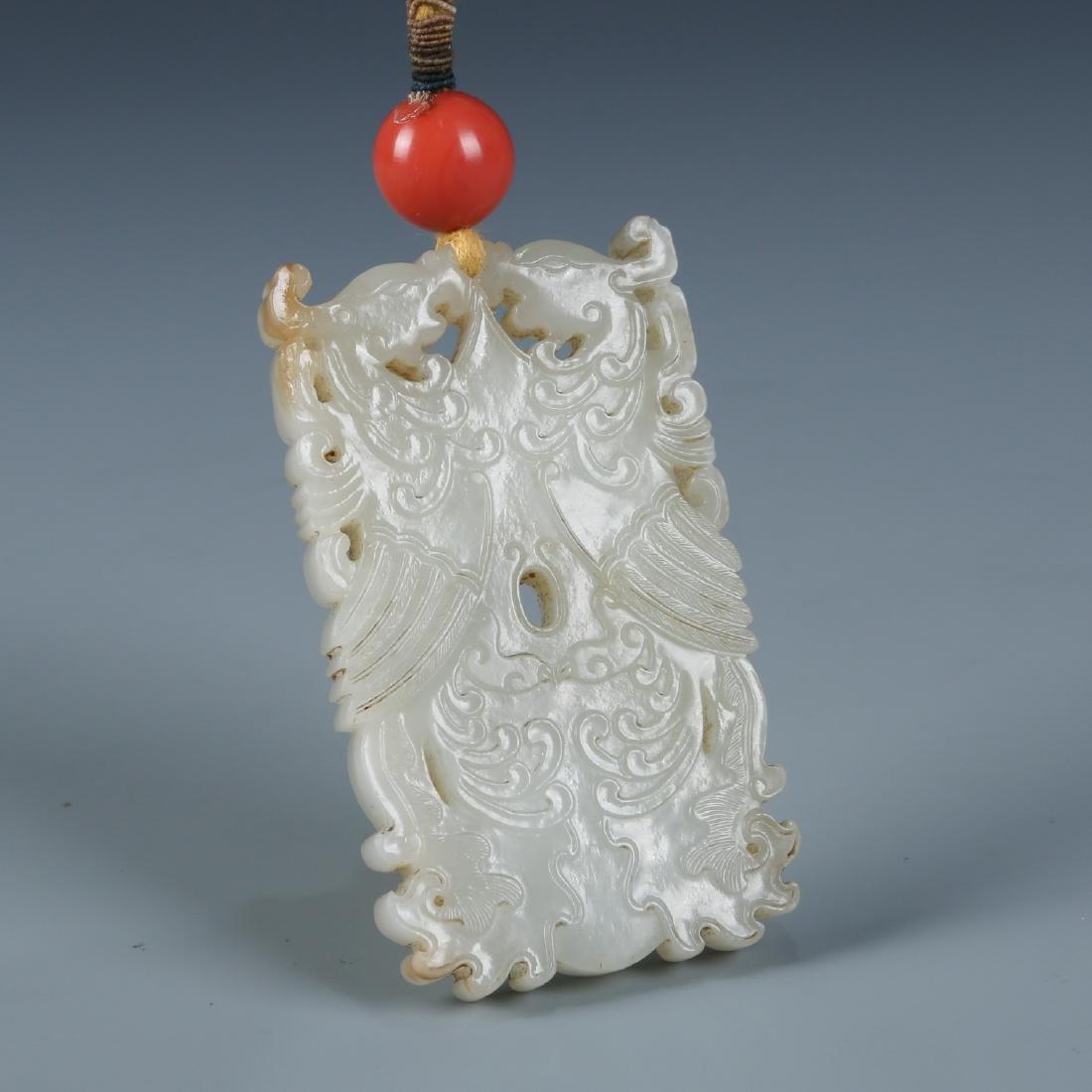 A Carved Rectangular 'Phoenix' White Jade Pendant