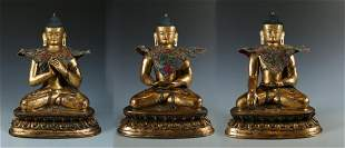Three Gilt Bronze Buddhas Seated In Various Poses