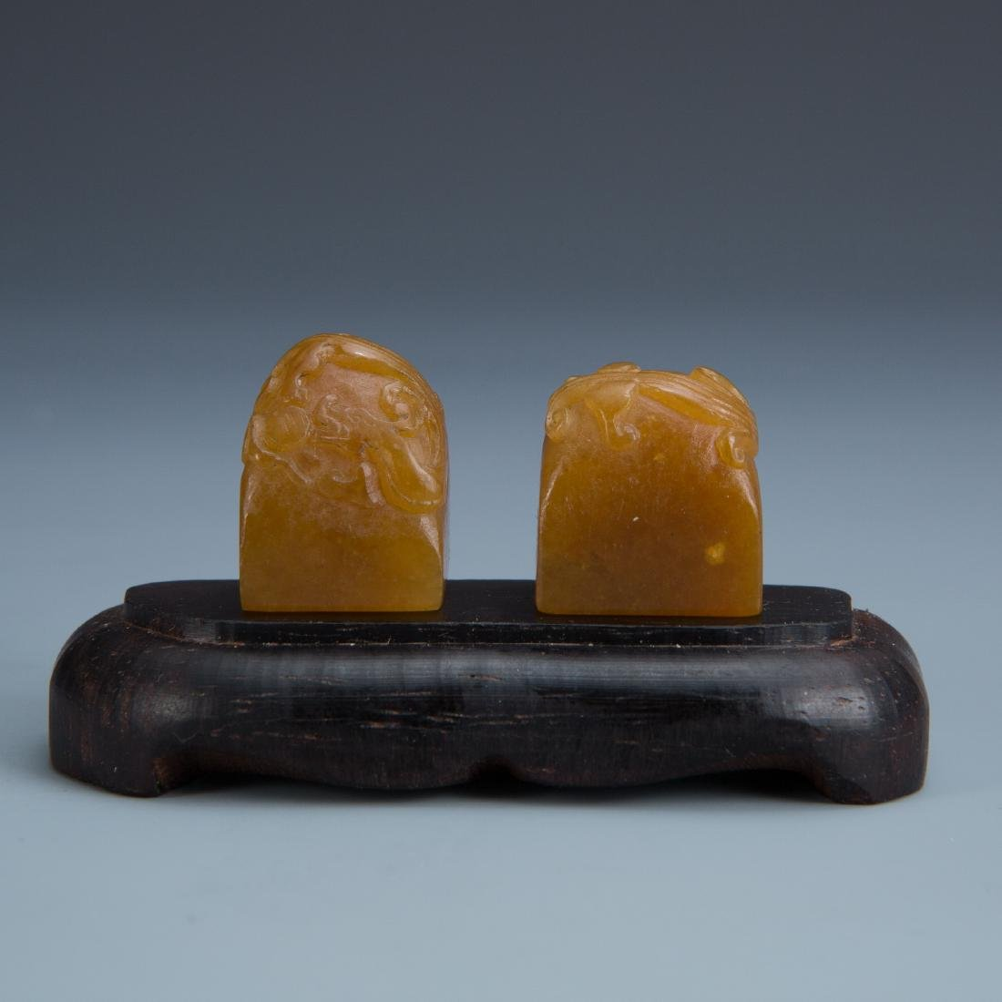 Pair of Carved Soapstone Serpent Stones on Wood Tray