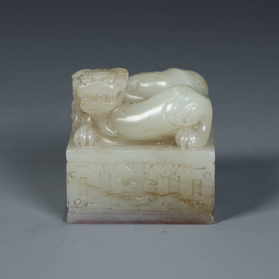 A Chinese White Jade Carved Mythical Beast Seal