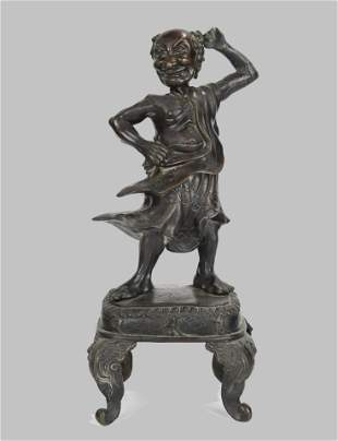 A BRONZE STANDING FIGURE ON STAND