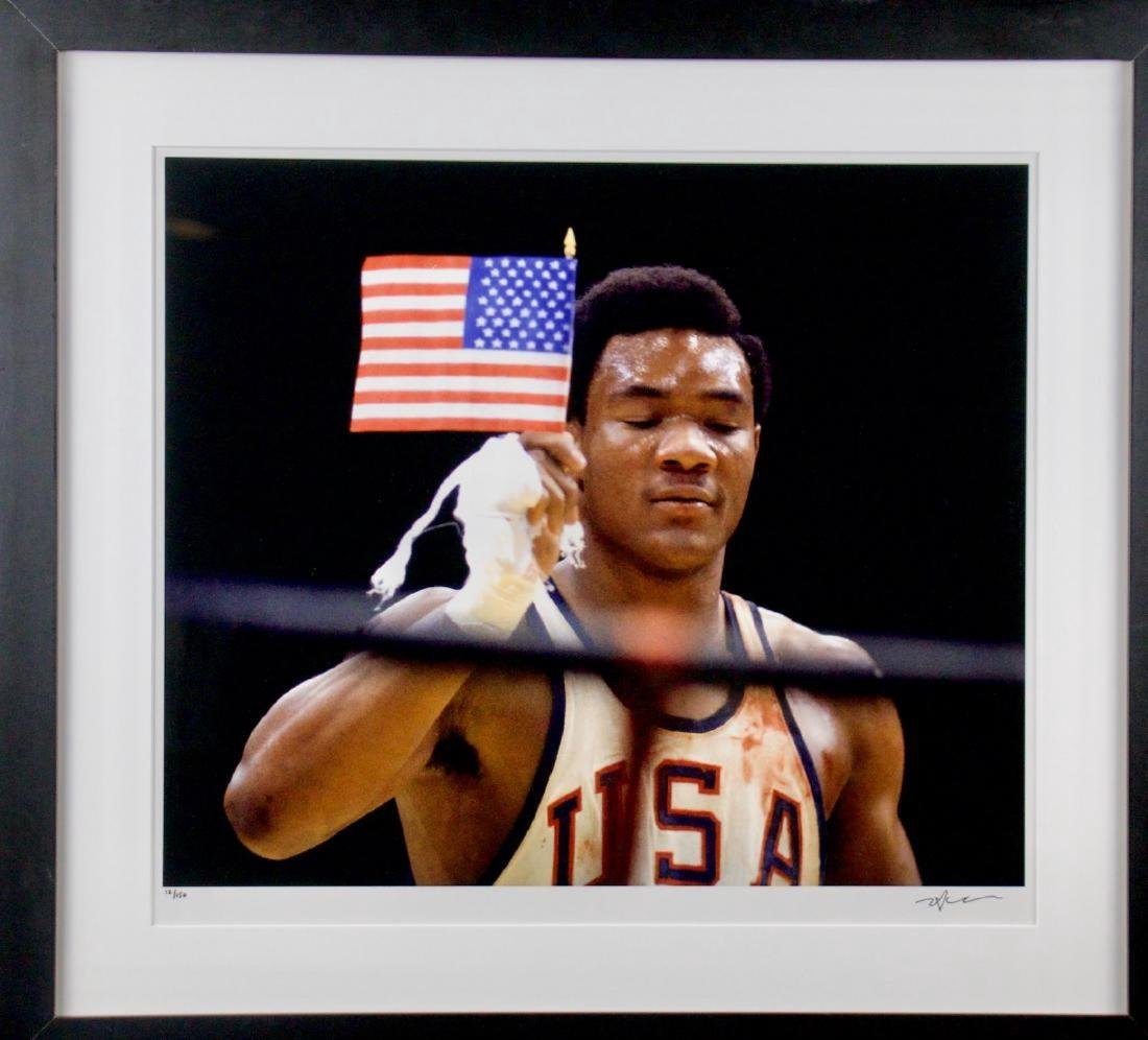 Neil Leifer- George Foreman with flag