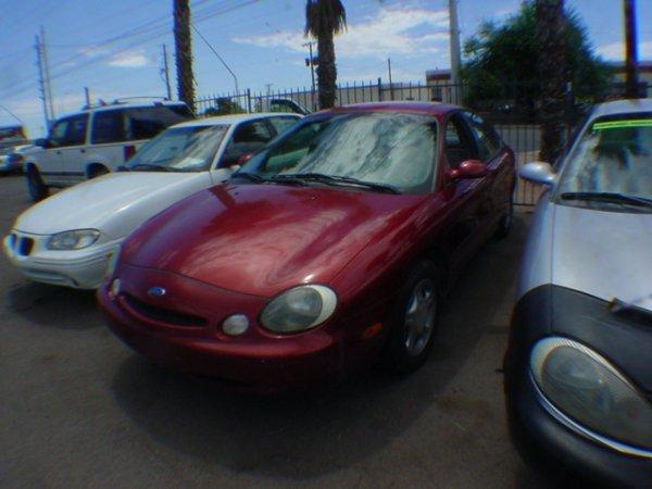 3017: 1997 Ford Tarus miles Vin# IFALP52U8VA277086