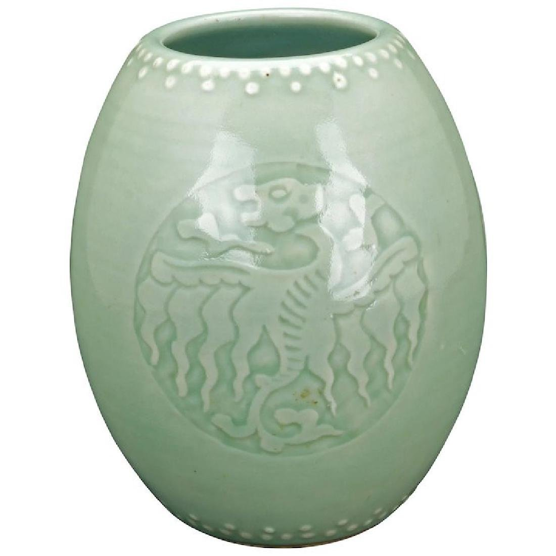 Chinese porcelain celadon glazed drum vase with a