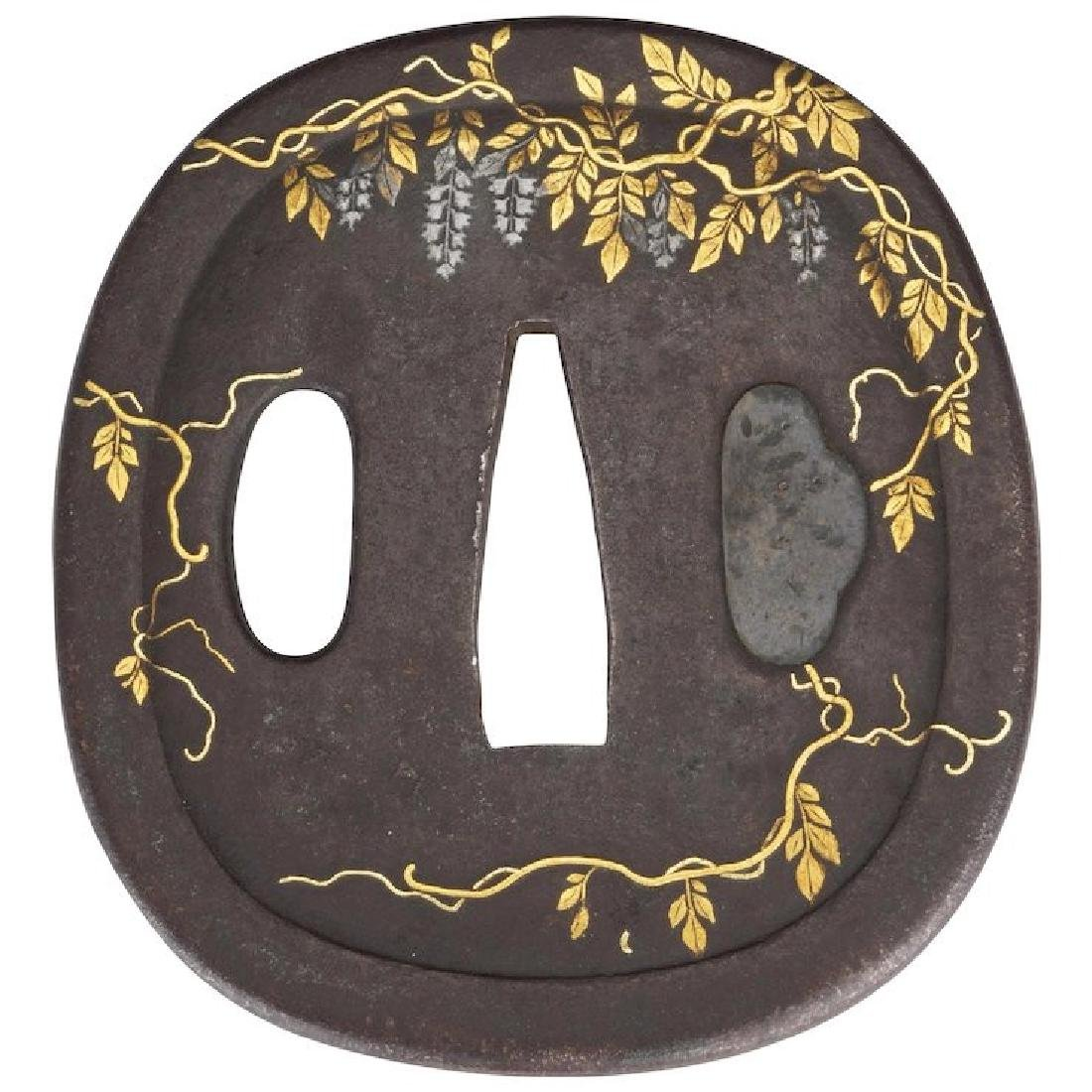 Japanese cast iron Tsuba with inlays of wisteria 19th