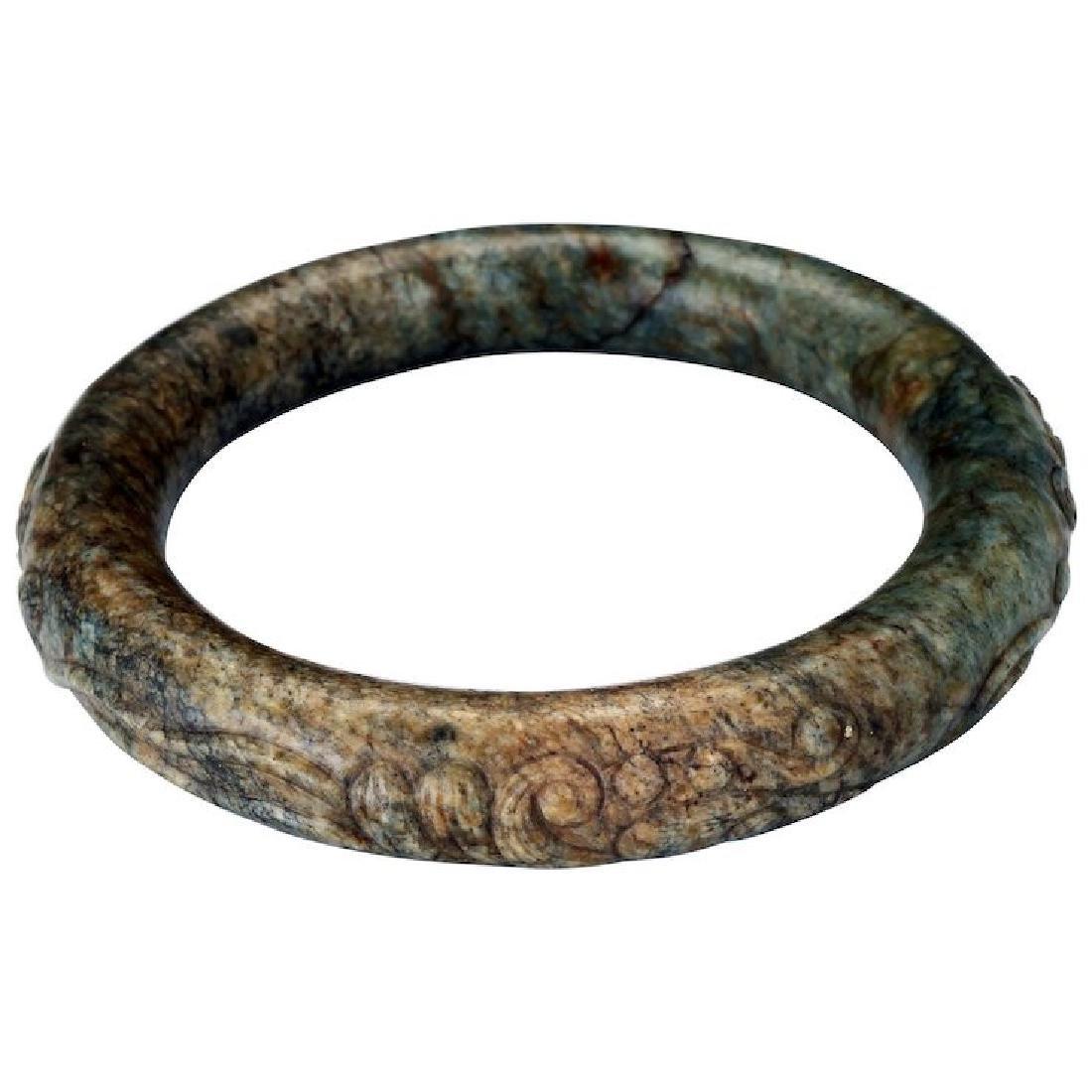 Chinese toroid form 63 mm mottled hardstone bangle