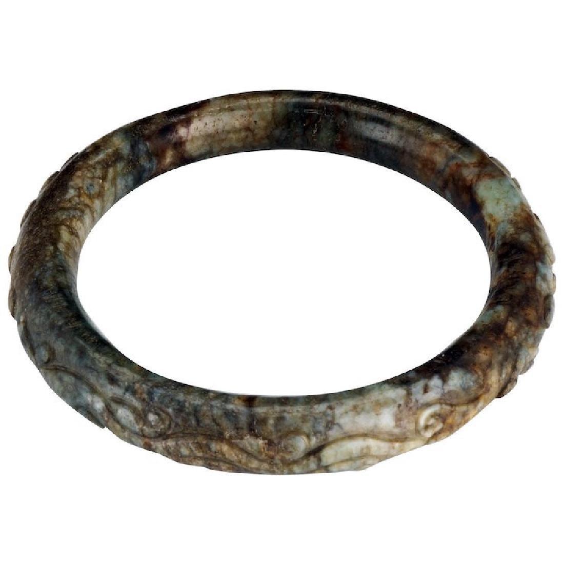 Chinese toroid form 65 mm mottled hardstone bangle