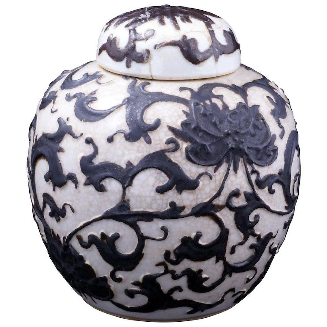 Chinese porcelain ginger jar with lid and raised design