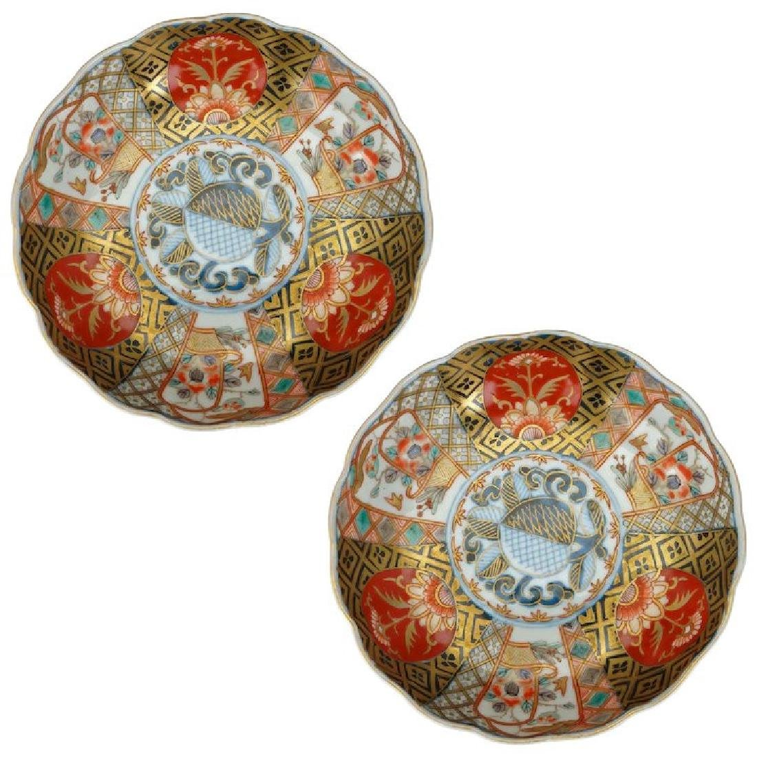 Matching pair of round Japanese porcelain colored Imari