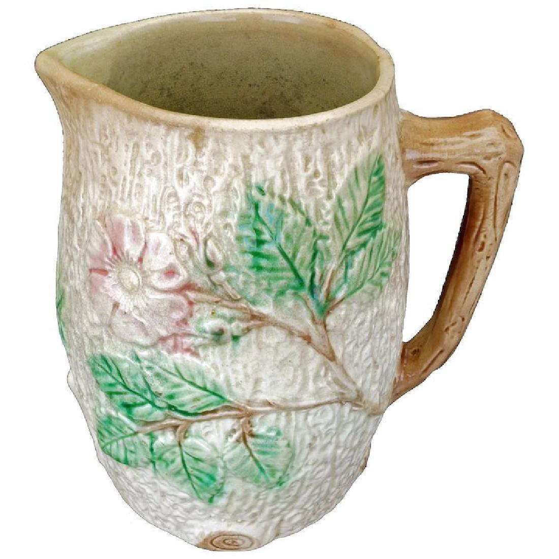 Ceramic majolica pitcher with apple blossom design