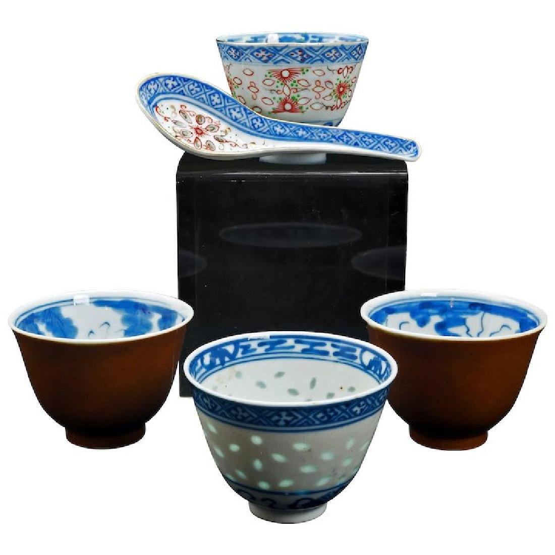 Grouping of four Chinese porcelain teacups and spoon