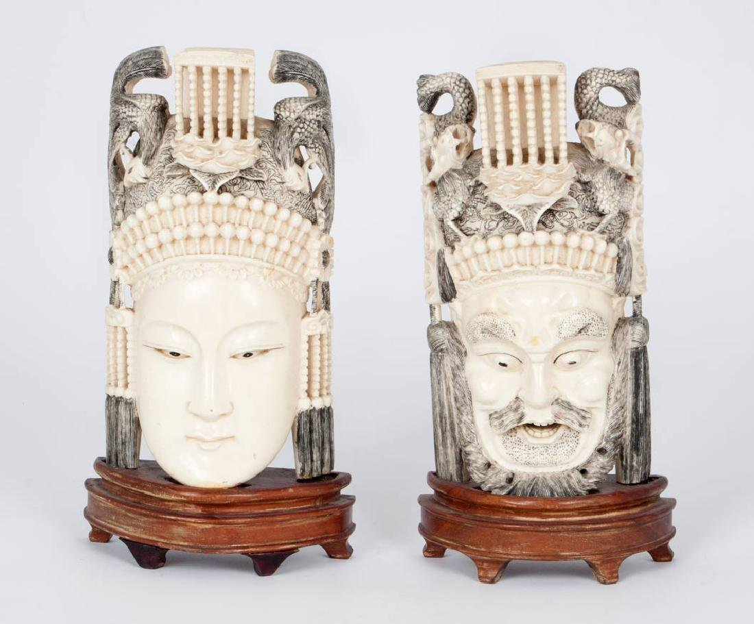 A Pair of Carved Ivory Masks of the Emperor and Empress