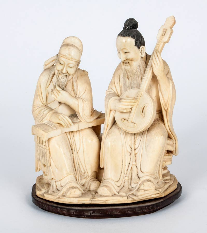 A Carved Ivory Figurine of Two Musicians, China, Early