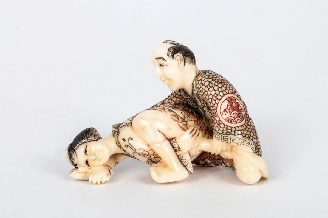 A Carved Ivory Shunga Netsuke, Japan, 19th Century