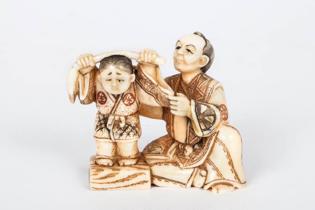 A Carved Ivory Netsuke, of a Father and Child, Japan