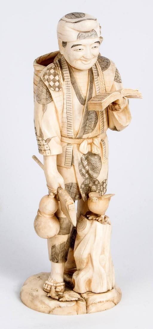A Carved Ivory Netsuke of a Man with a Fan, Japan, 19th