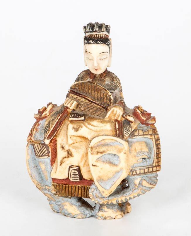 A Polychrome Carved Ivory Female Figure on an Elephant,