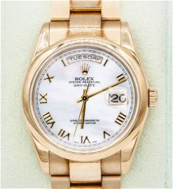 A Rolex Oyster 18K Yellow Gold Perpetual Day-Date