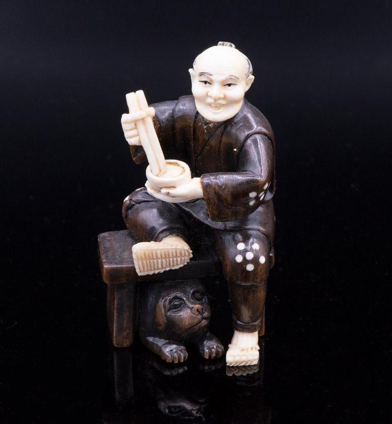 A Fine Japanese Wood Netsuke of Man Eating Noodles,