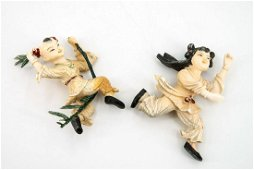 A Pair of Carved   Polychrome Figurines, China,