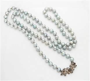 A Fine 18K White Gold Grey Pearl Diamond and Sapphire