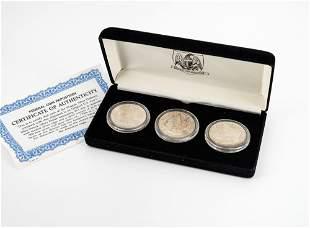 A Set of Three Morgan Fine Silver .900 Dollar(s),