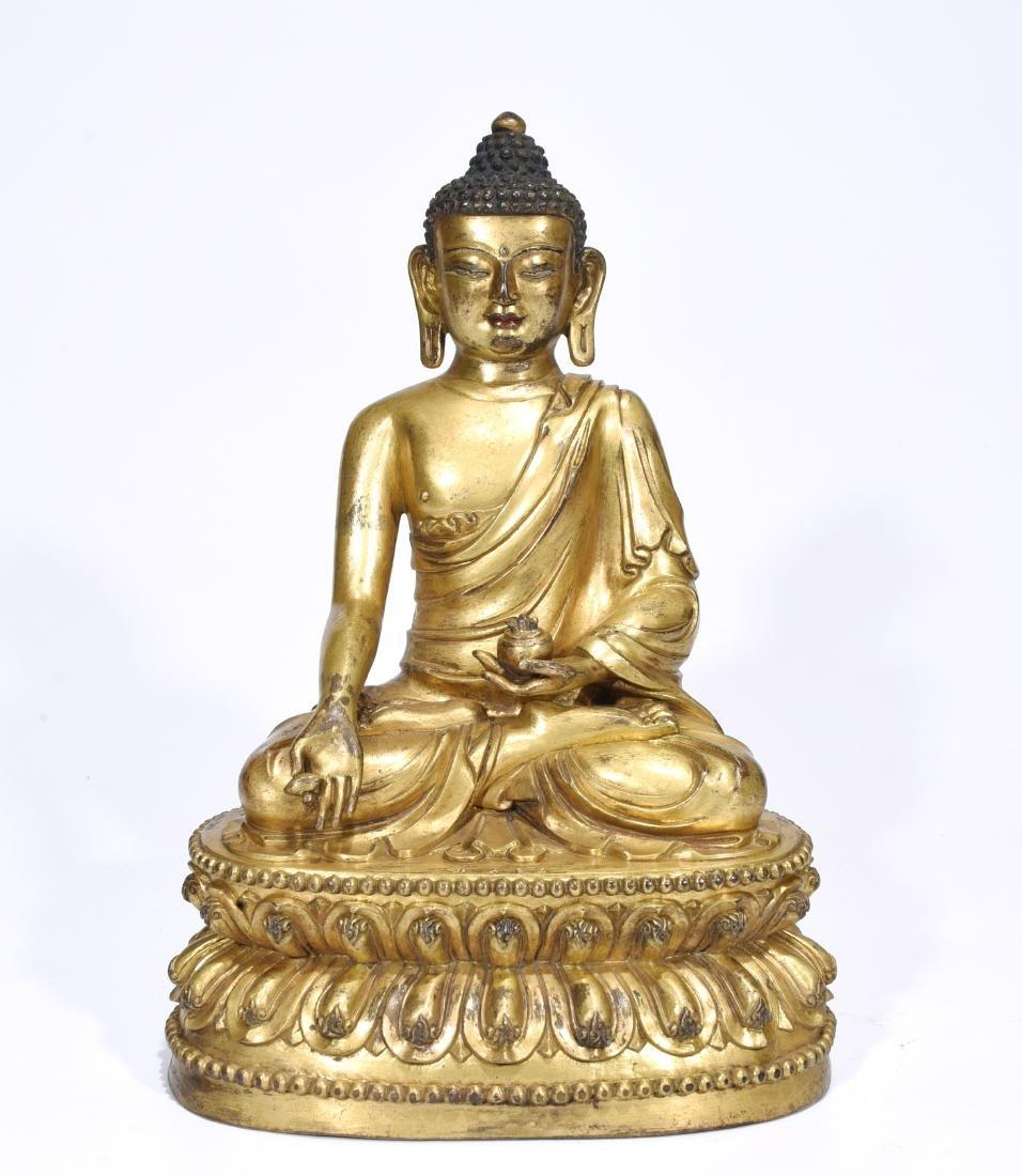 A Gilt Bronze Shakyamuni Sculpture