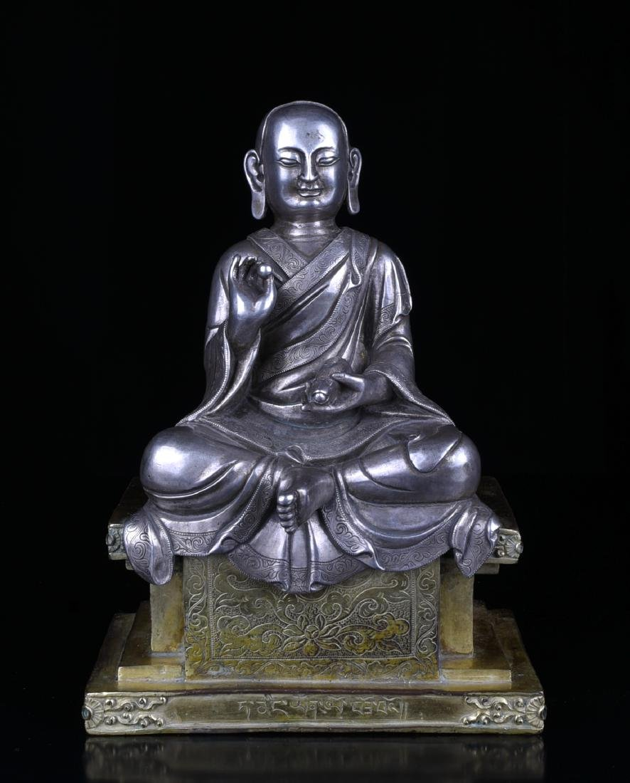 A Silver Luohan Statue with Gilt Bronze Stand