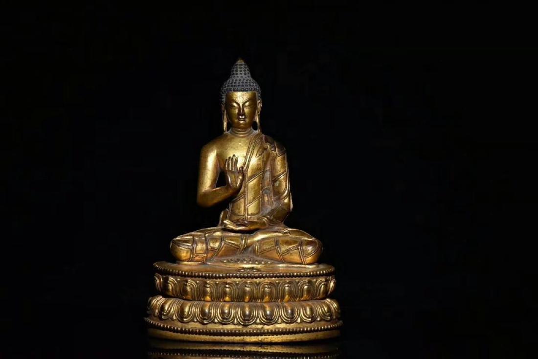 17 C., A Gilt Bronze Buddha Statue