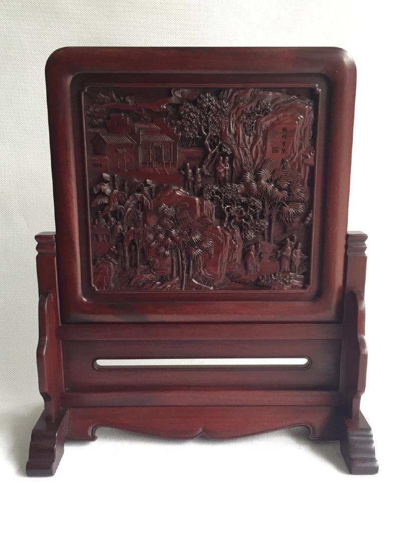A Carved Hardwood Plaque