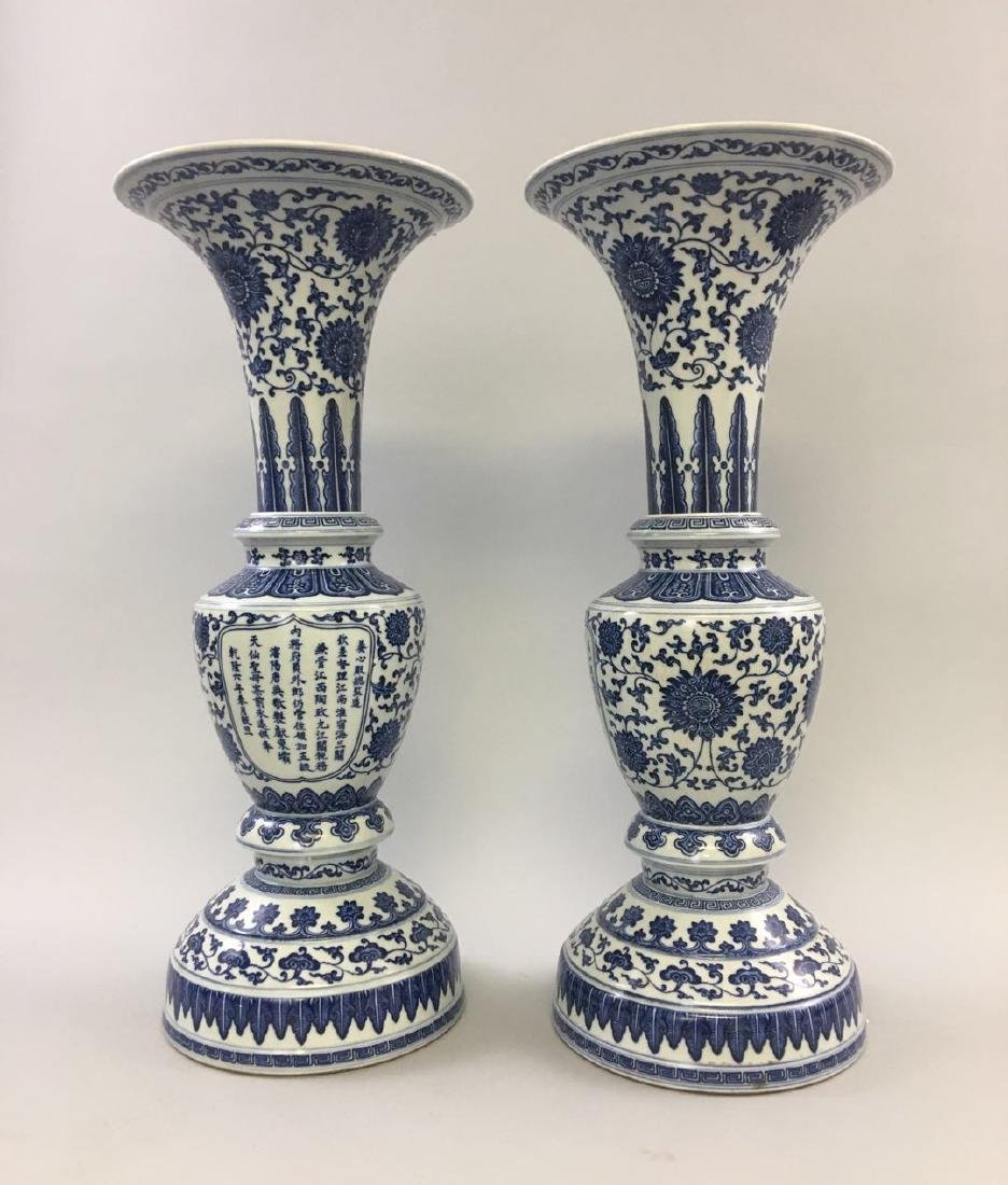 A Pair of Tang Ying Blue and White Gu Vases