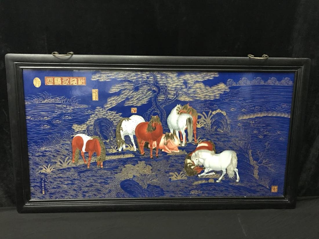 A Gilt and Blue Porcelain Plaque