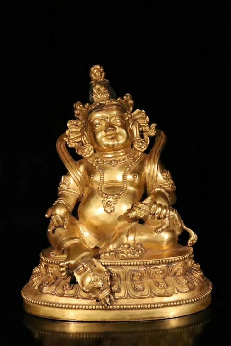 18 C., A Gilt Bronze Buddha Statue