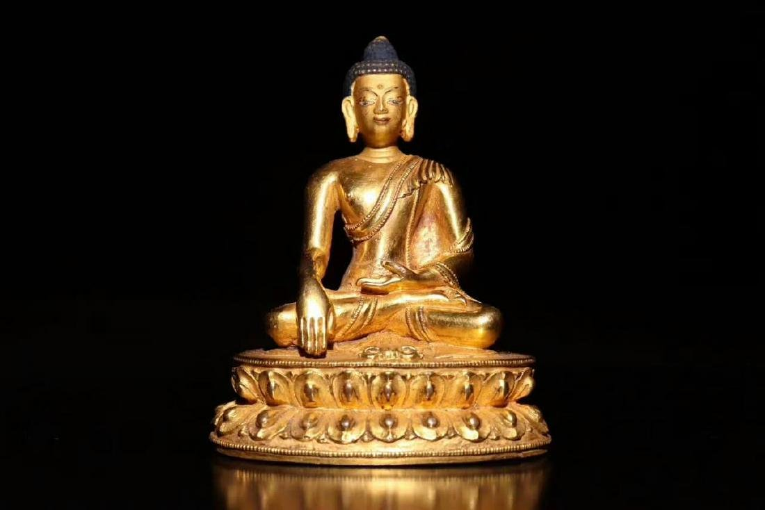 18 C., A Gilt Bronze Buddha Statue of Sakyamuni