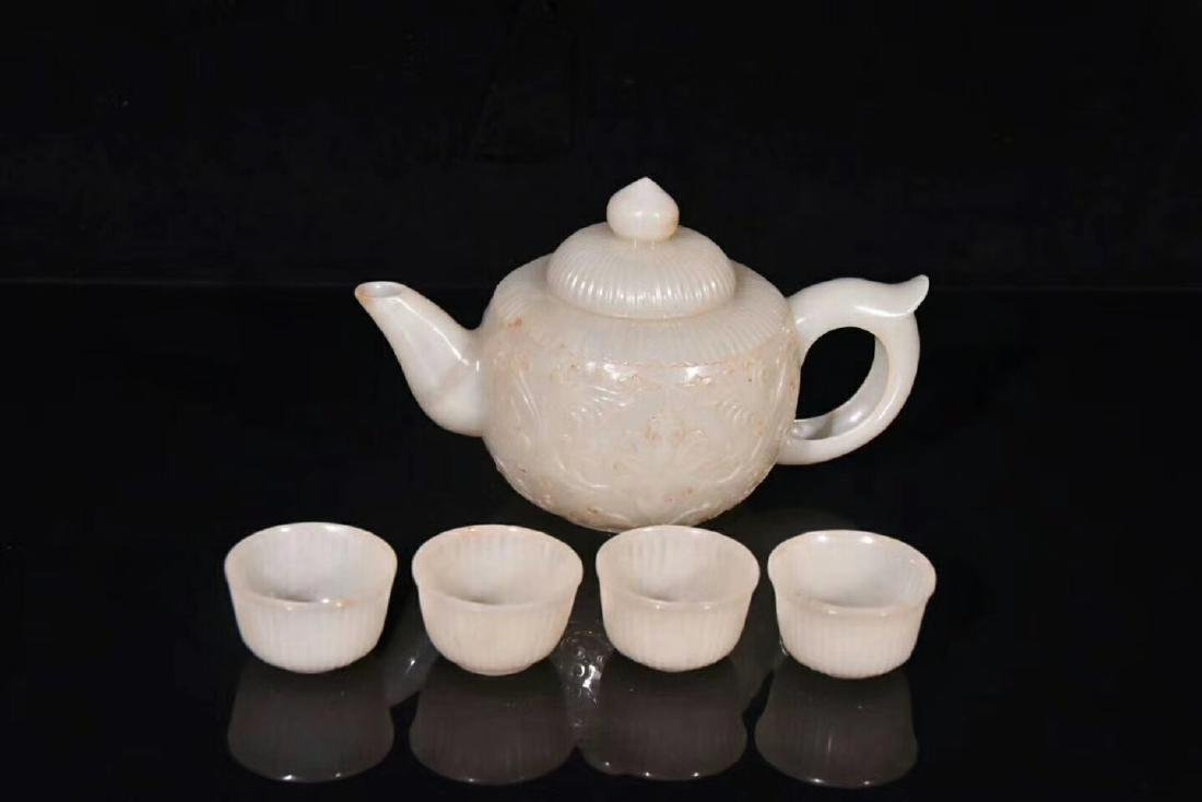 A Carved Hetian Jade Teapot With Four Cups