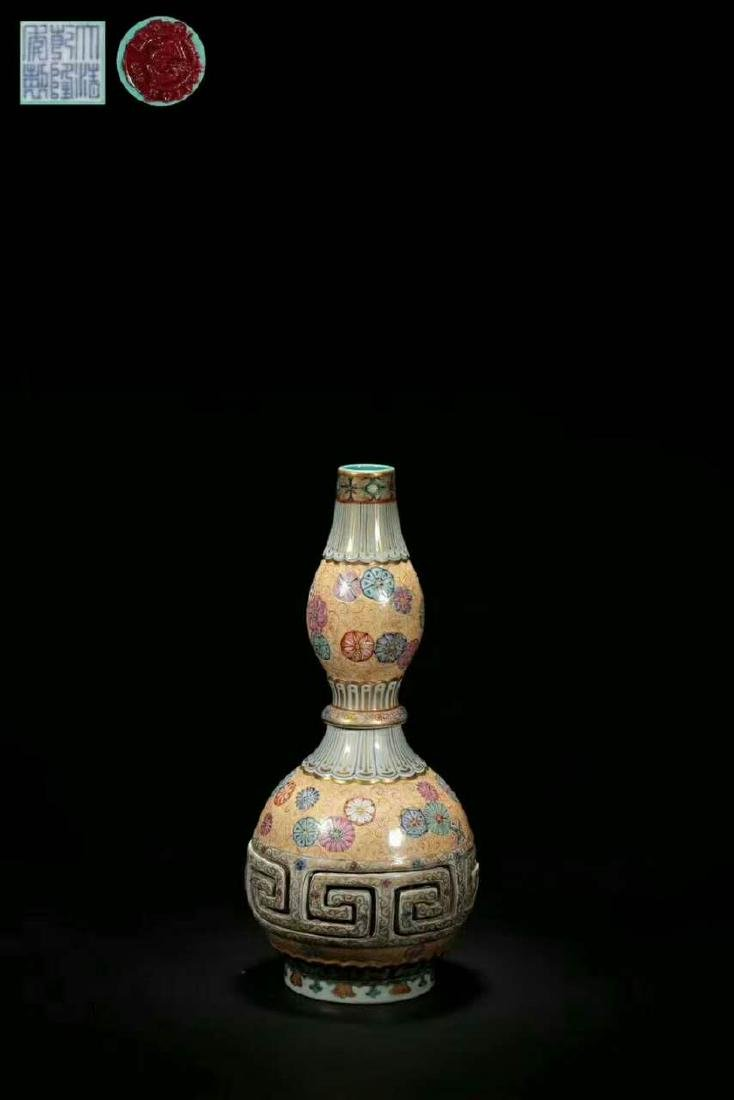 Qianlong Mark, A Gilt Famille Rose Gourd Vase
