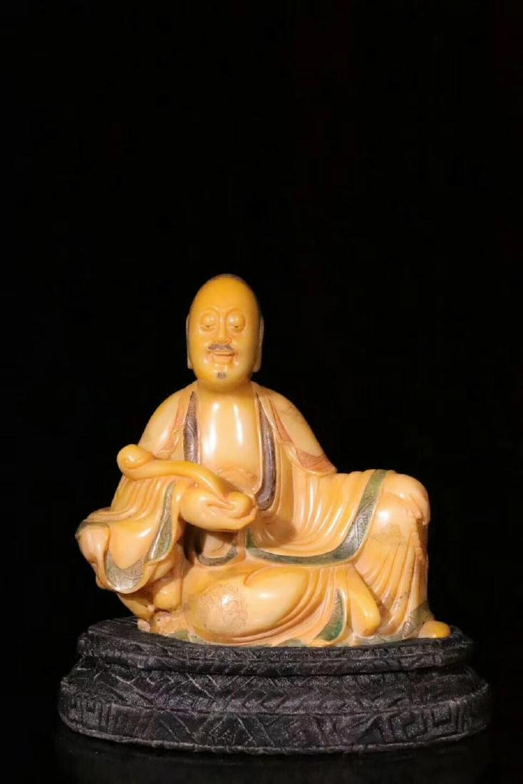 A Carved Tianhuang Stone Figure of Luohan