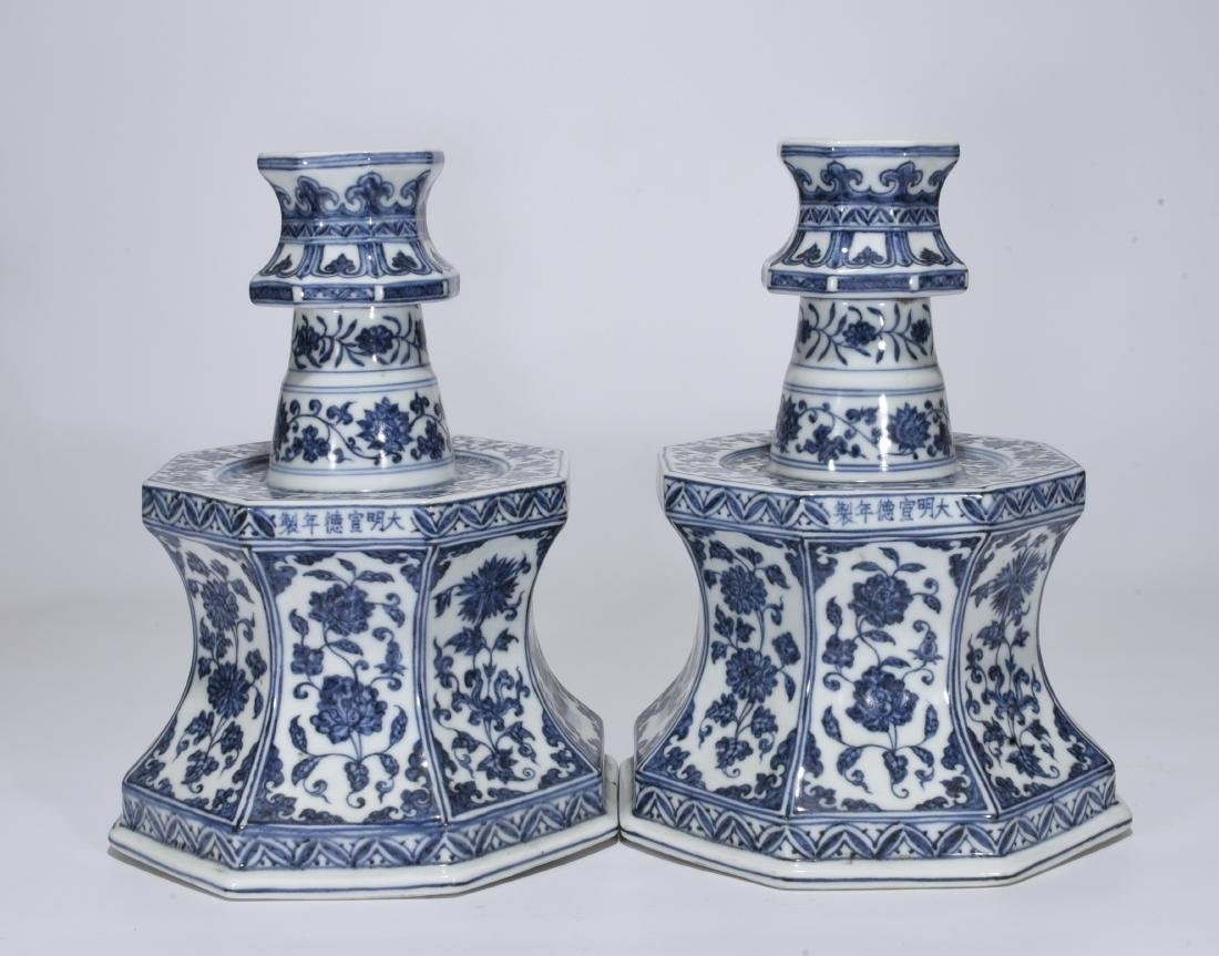 A Pair of Blue and White Candle Stand