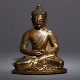 A Gilt Bronze Nepalese Buddha Statue
