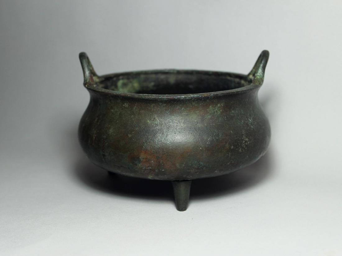 A Bronze Tripod Censer