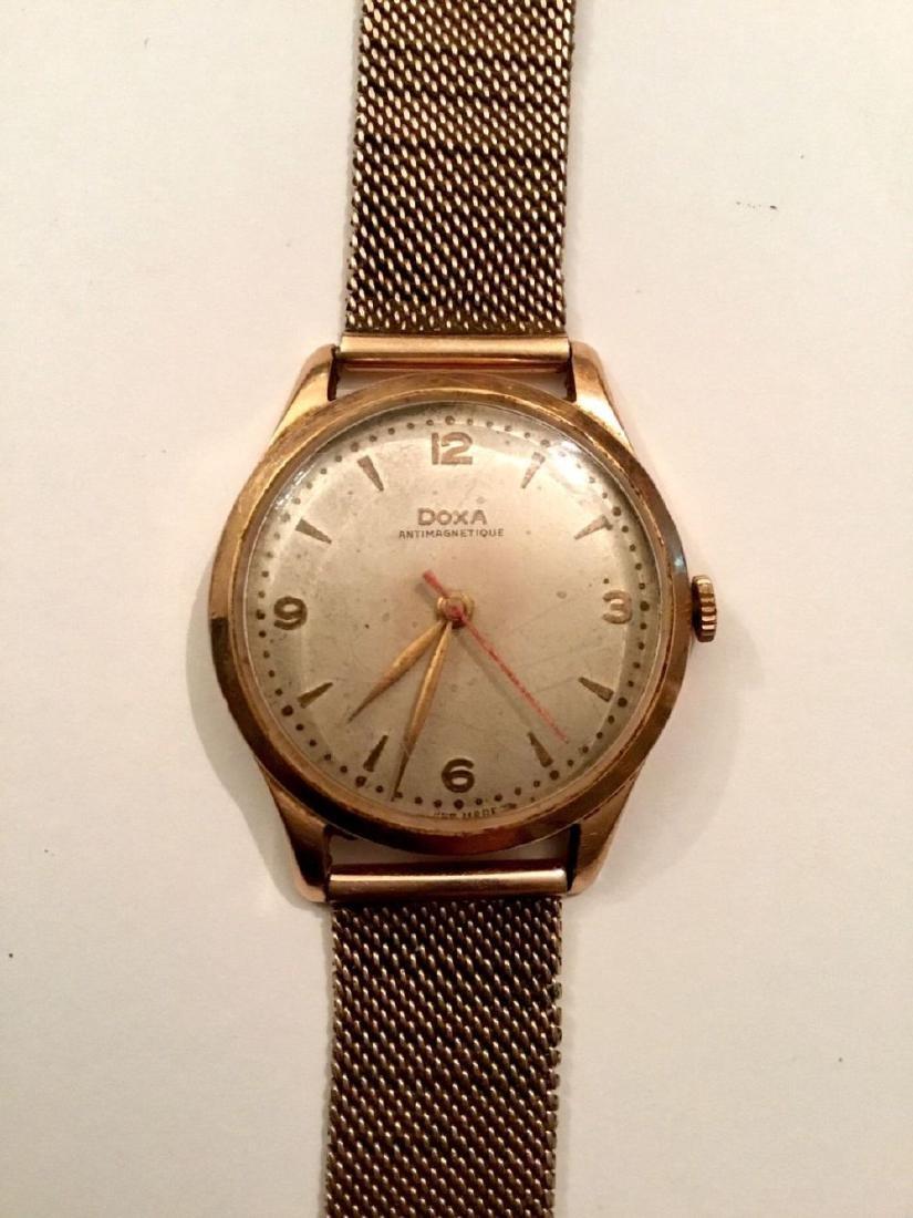 Doxa men's wristwatch, 14 karat gold, 53 g.   ש